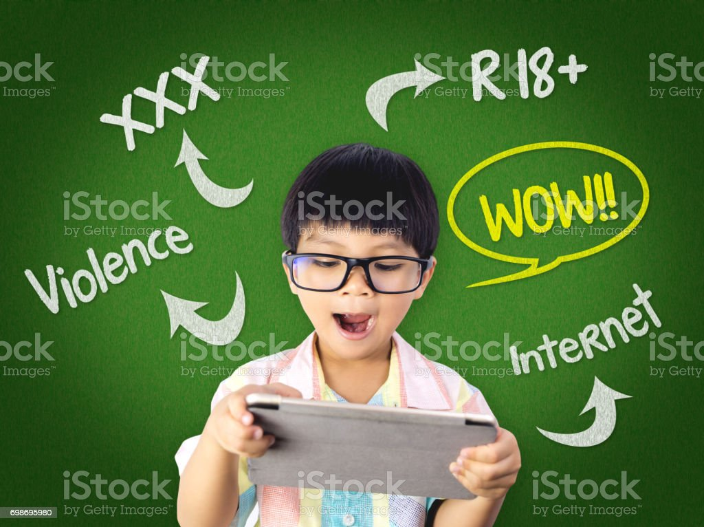 Kid is surprising on Dangerous contents on Internet stock photo