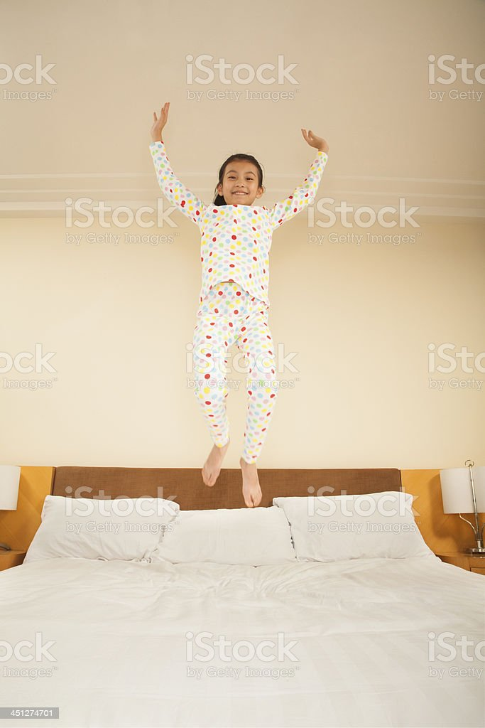Kid Jumping on Bed royalty-free stock photo