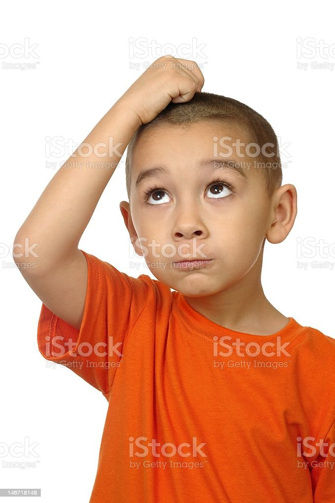 kid looking up confused, five years old stock photo