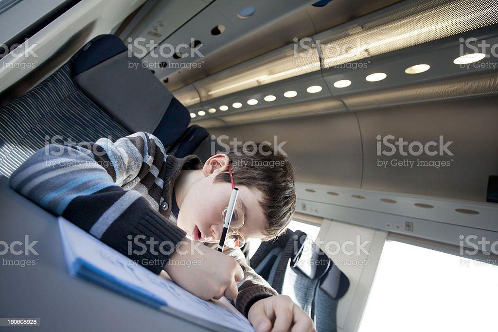 kid makes homework's on a train royalty-free stock photo