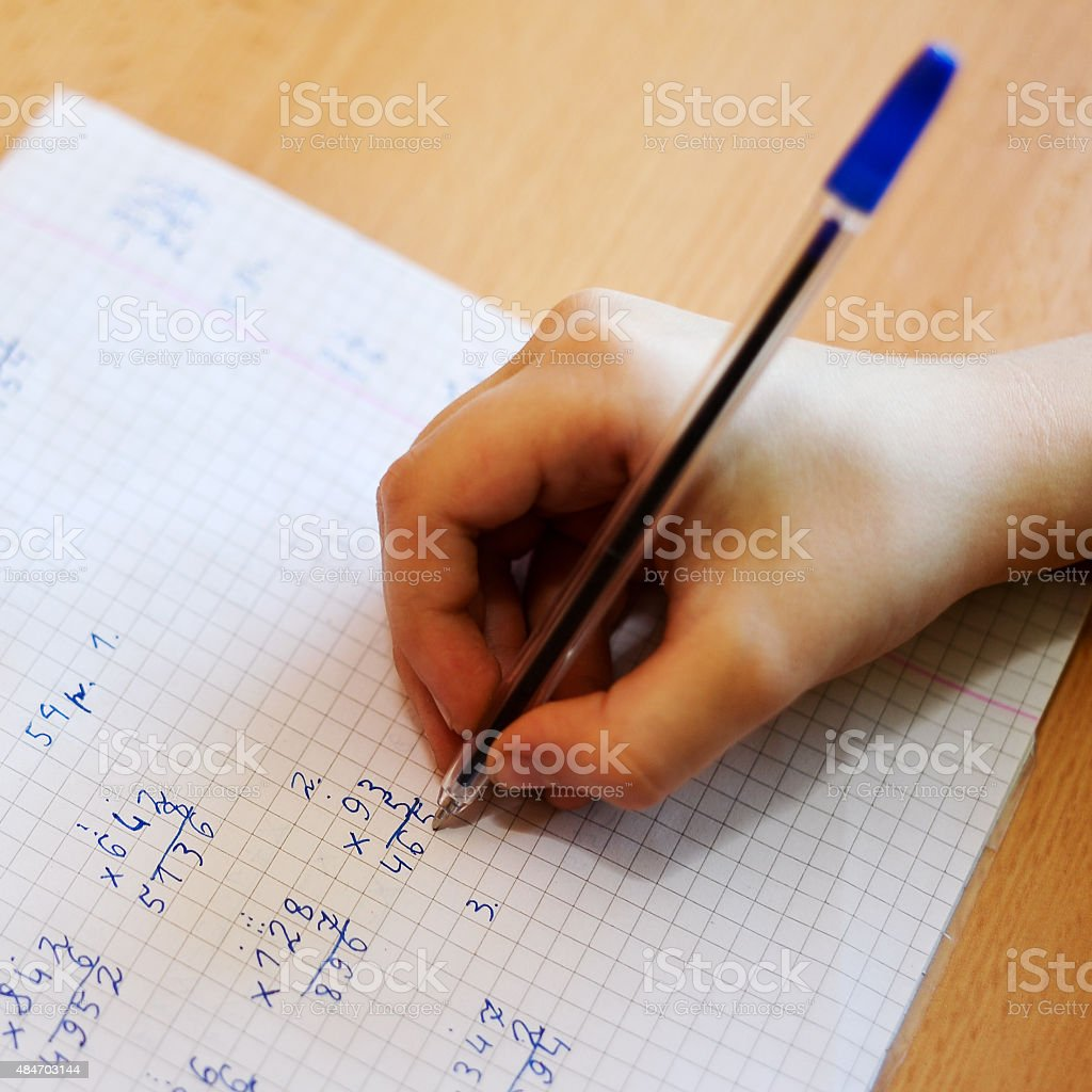 Kid making home work for school stock photo