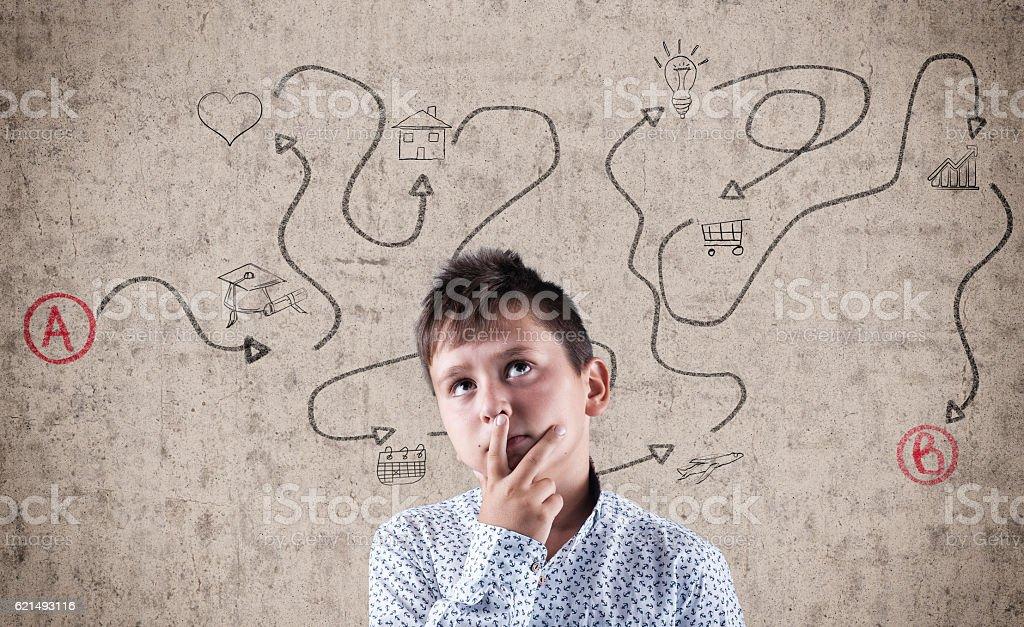 Kid next to wall stock photo
