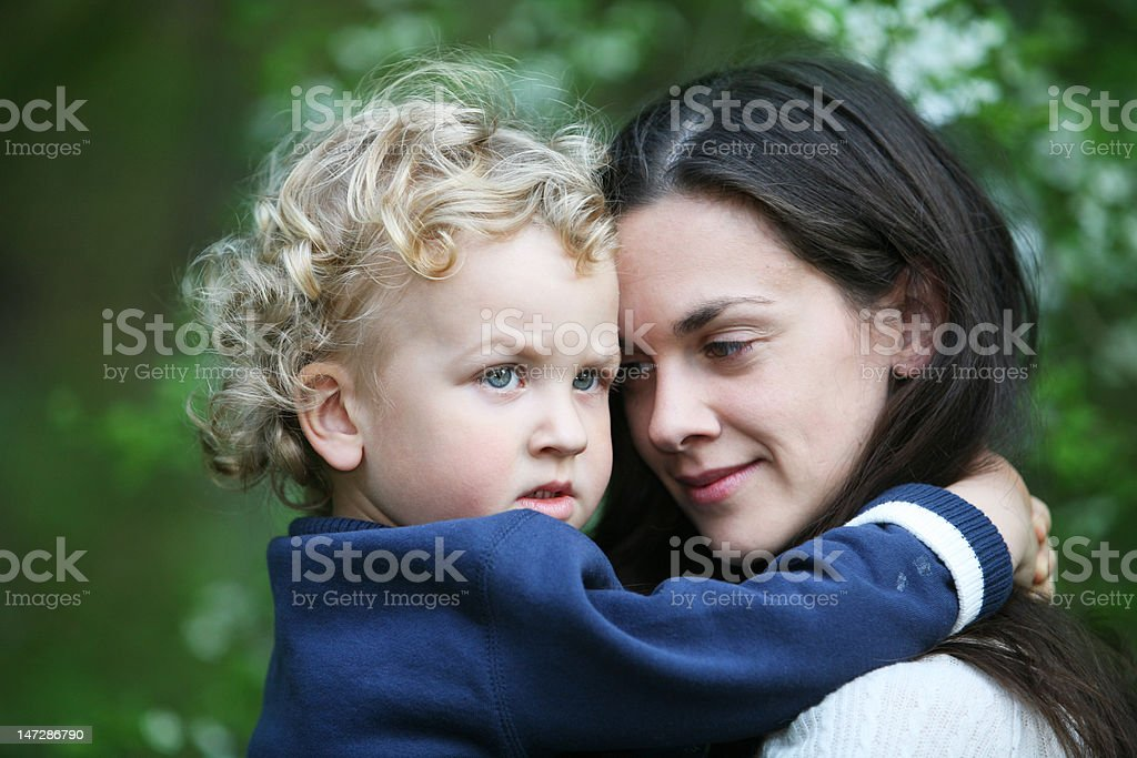 Kid on mothers hands royalty-free stock photo