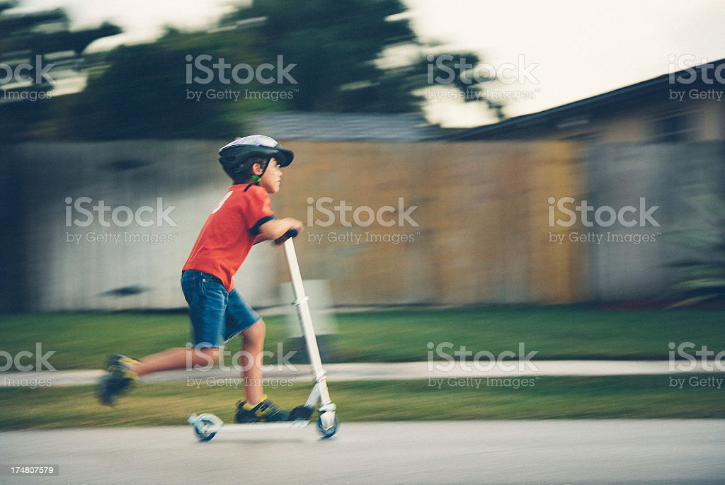 kid on pushing scooter royalty-free stock photo