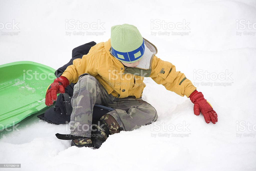Kid On Snow Digging royalty-free stock photo