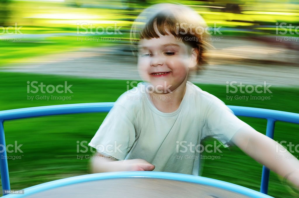 Kid on the merry-go-round royalty-free stock photo