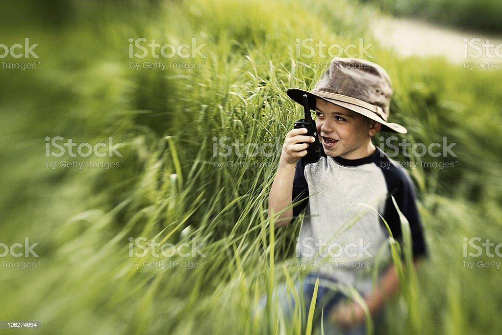 Kid on Walkie Talkie royalty-free stock photo