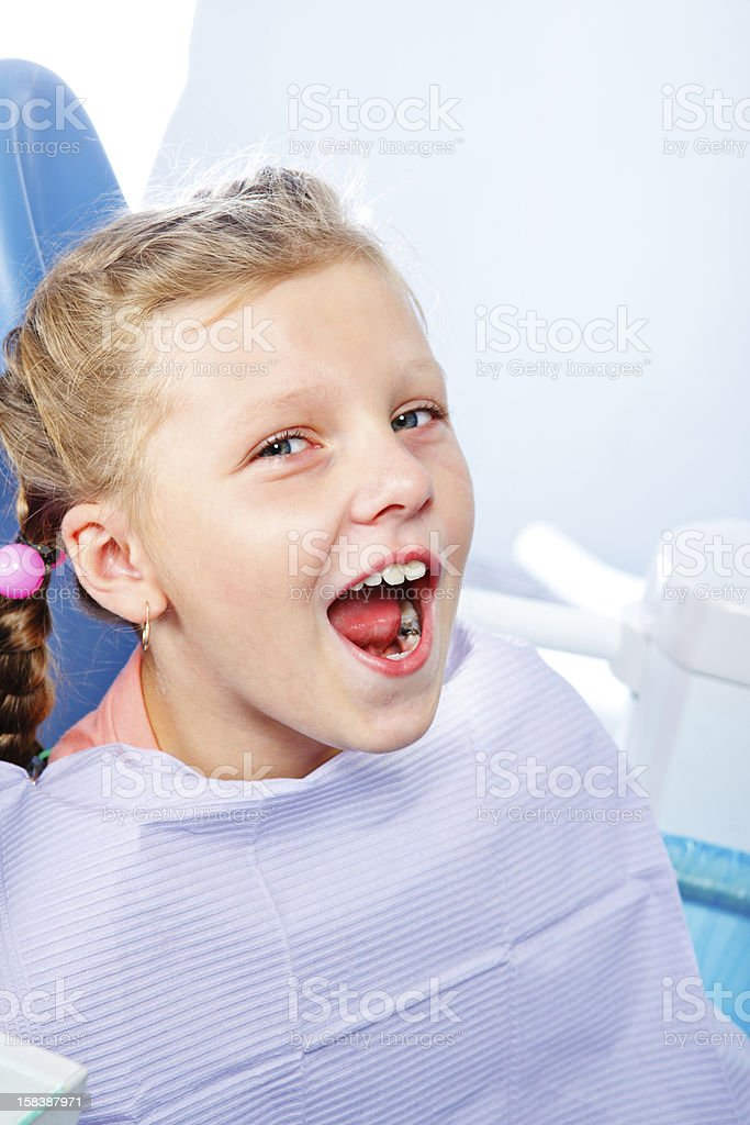 Kid opening mouth for oral exam stock photo