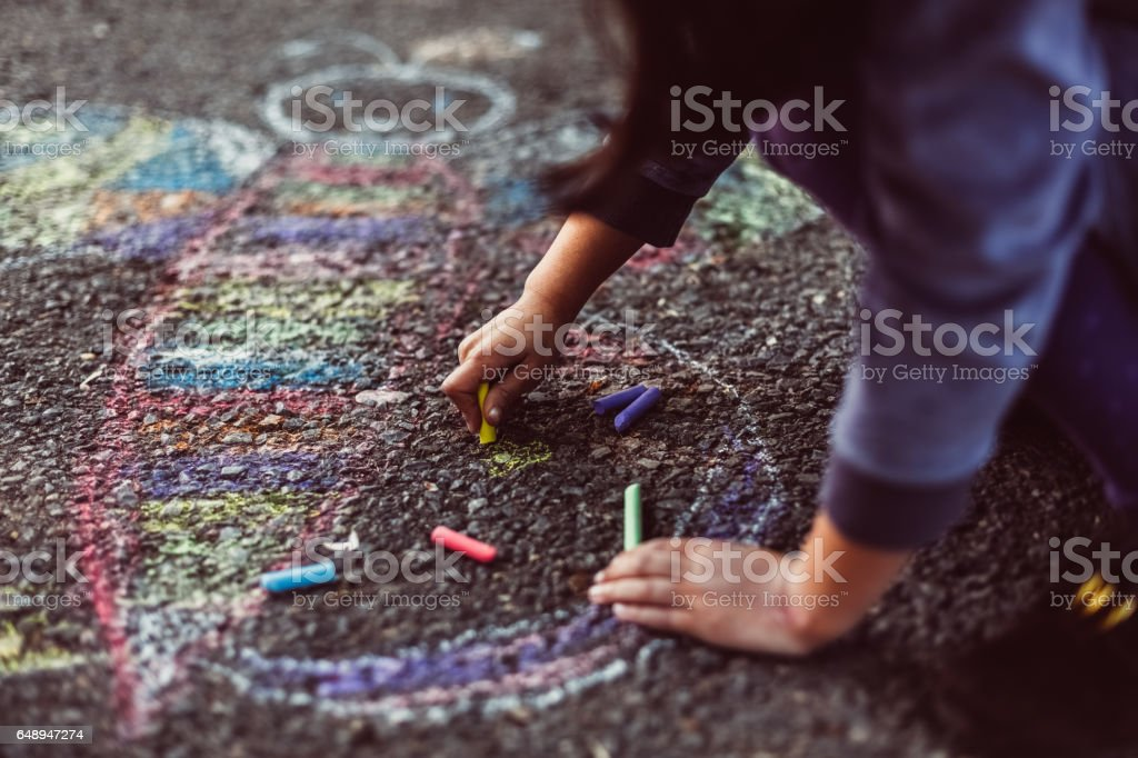 Kid painting on the ground stock photo