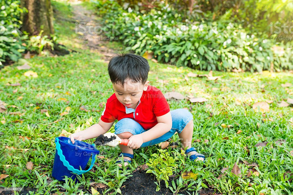 Kid planting stock photo