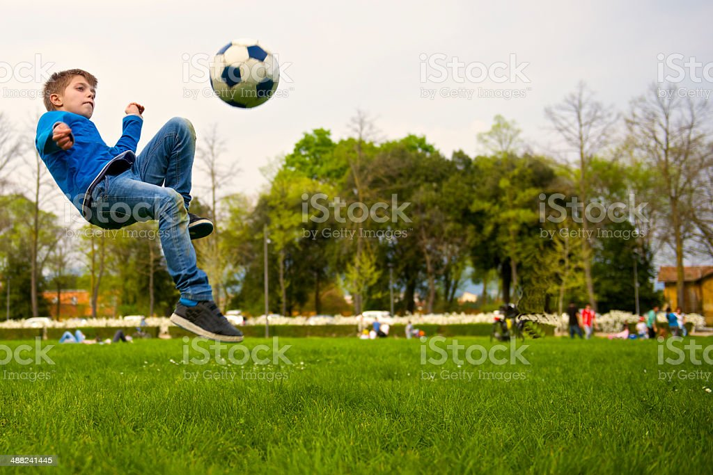 kid play soccer at the park in Florence snapshot royalty-free stock photo