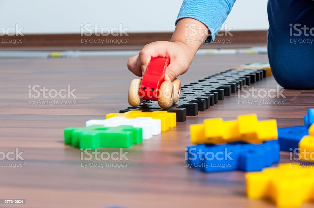 Kid play with toy stock photo