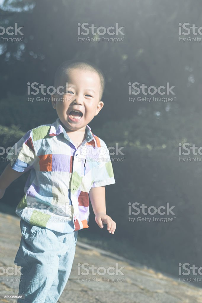 kid playing and smiling stock photo