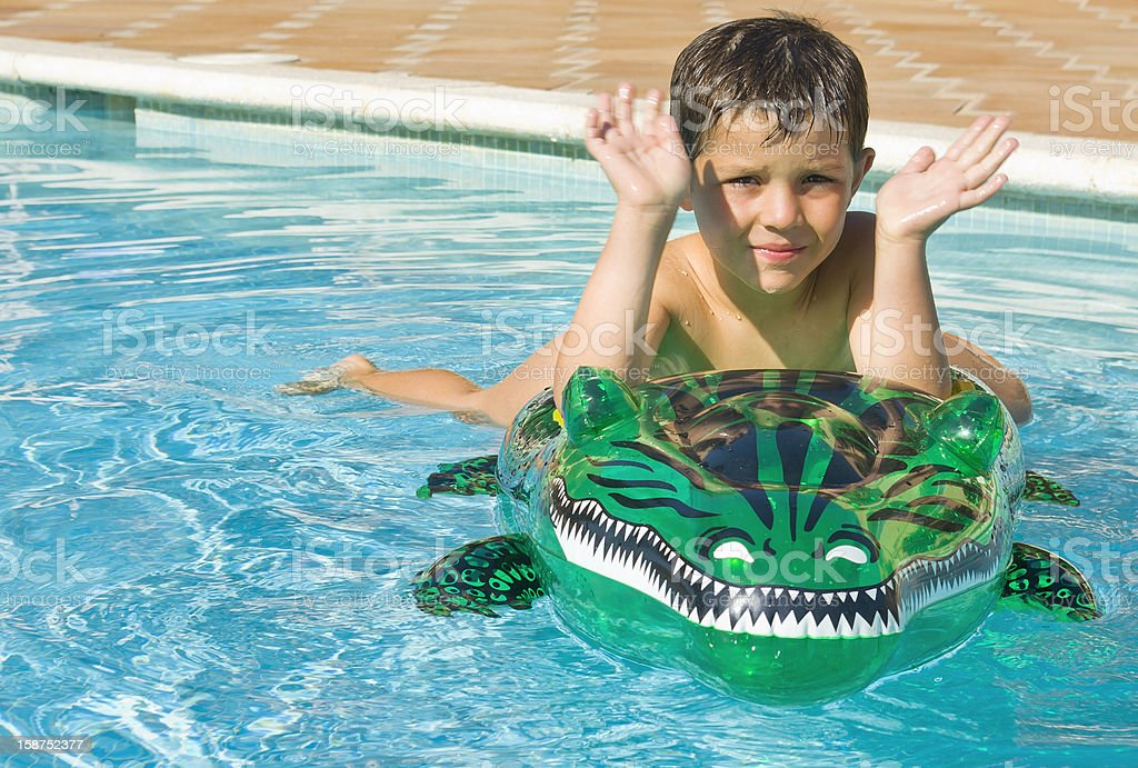 Kid playing at the swimming pool royalty-free stock photo