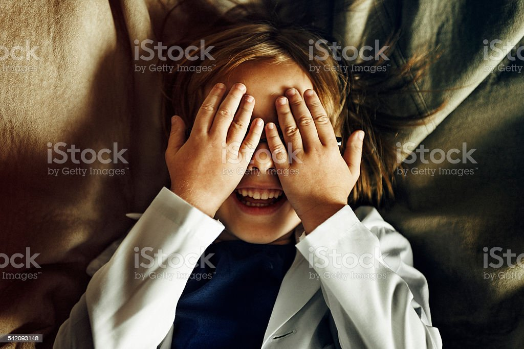 Kid Playing Hide Seek Smiling Concept stock photo