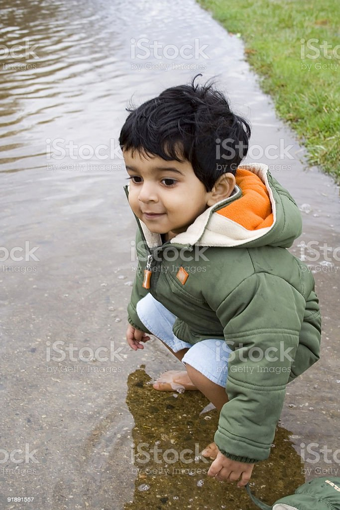 Kid playing in water. royalty-free stock photo