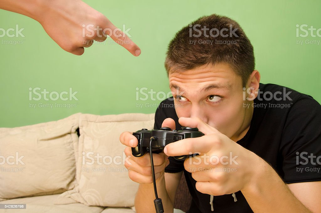 Kid playing video games too much stock photo