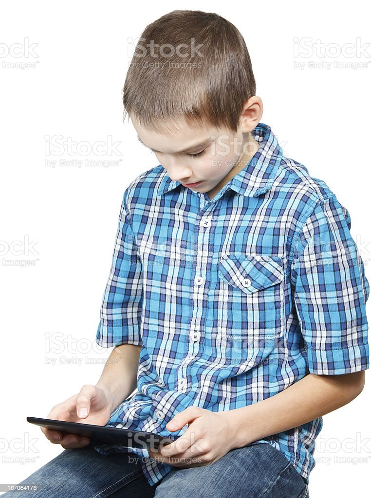 Kid playing with a tablet computer royalty-free stock photo