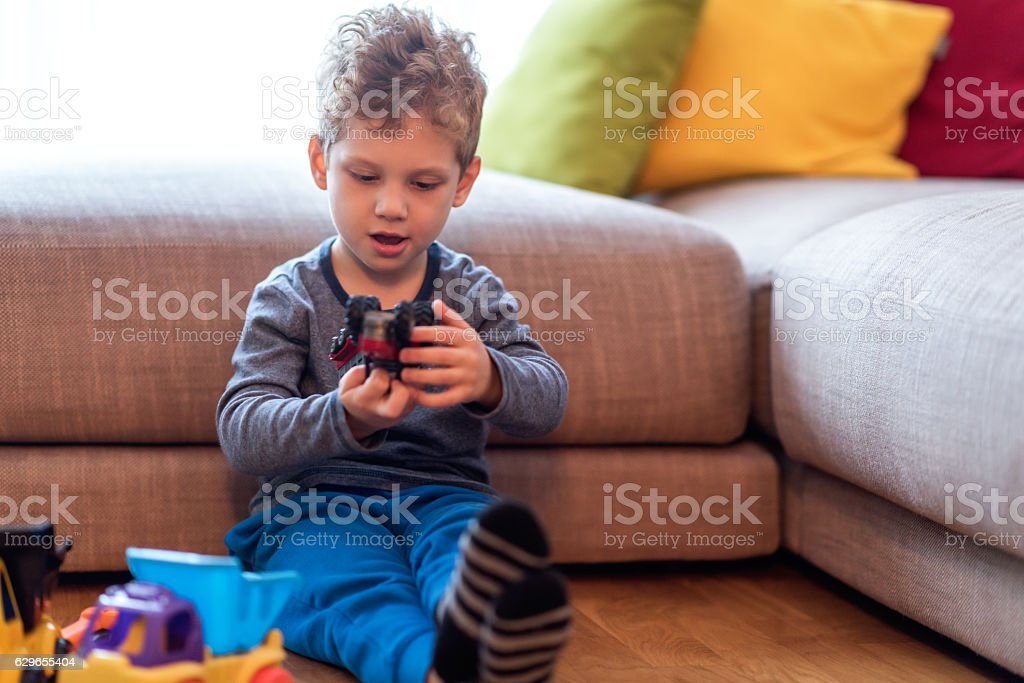 Kid playing with toys stock photo