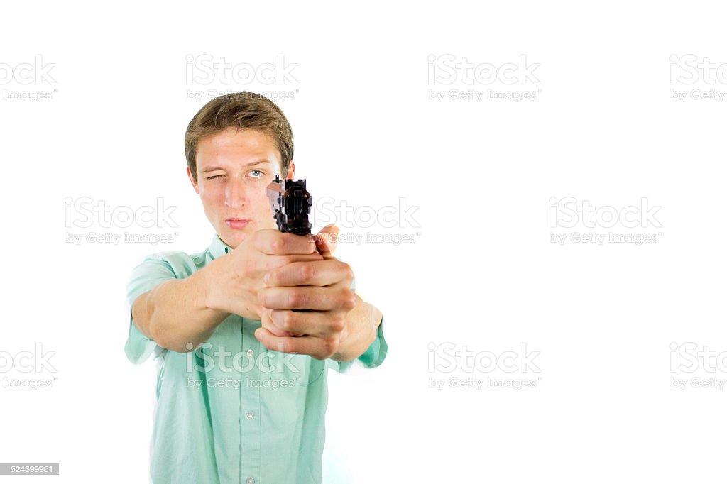 Kid pointing a gun at himself stock photo