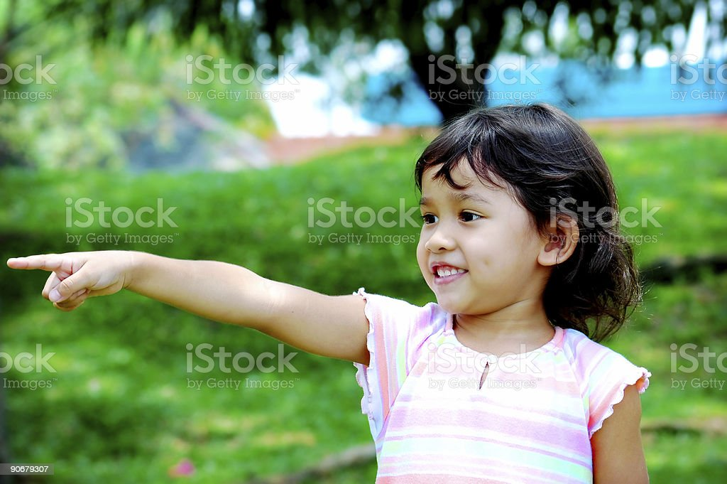 Kid pointing royalty-free stock photo