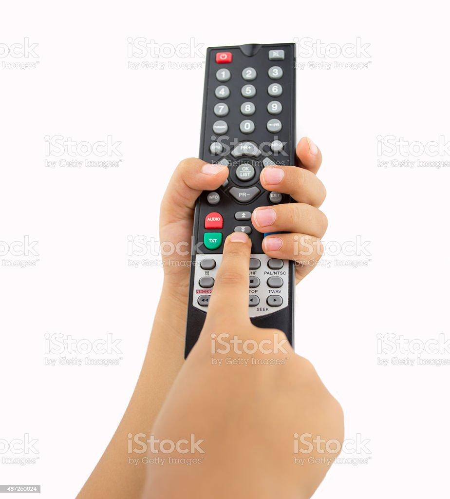 kid pressing the remote control stock photo