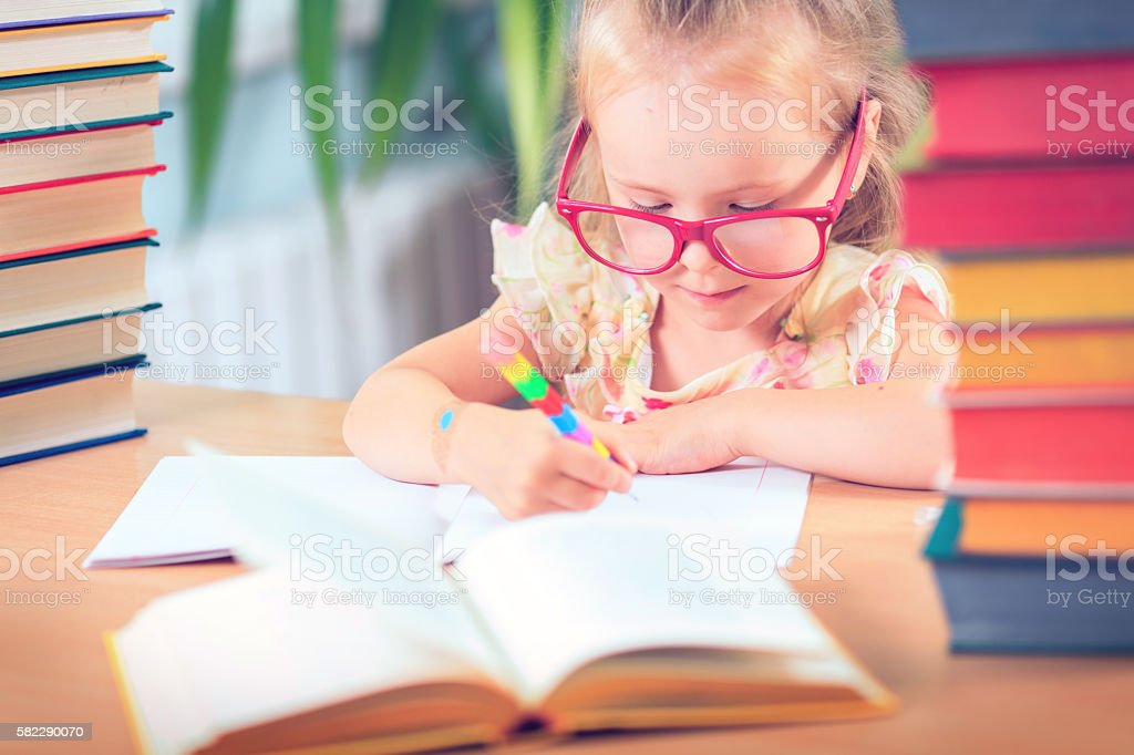 Kid  Reading Book, Pupil Learn Lesson and Dream, Education stock photo