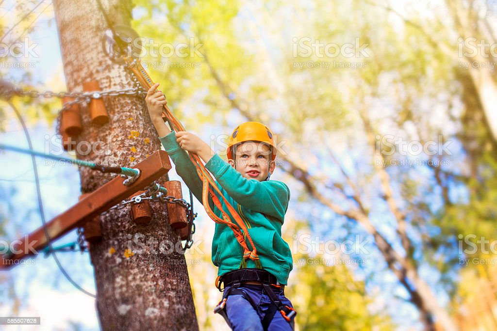 kid ready to zipline flight in adventure park stock photo