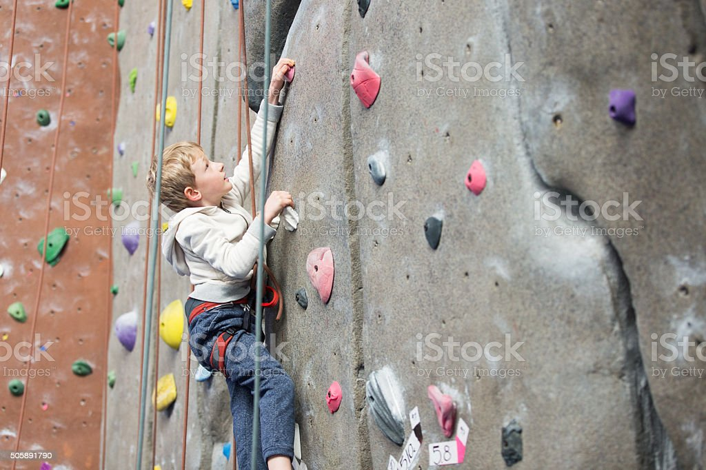 kid rock climbing stock photo