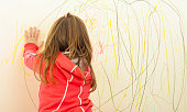Kid Scribble on the Wall