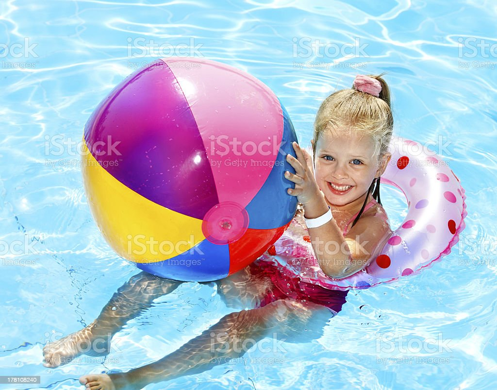 Kid sitting on inflatable ring. royalty-free stock photo