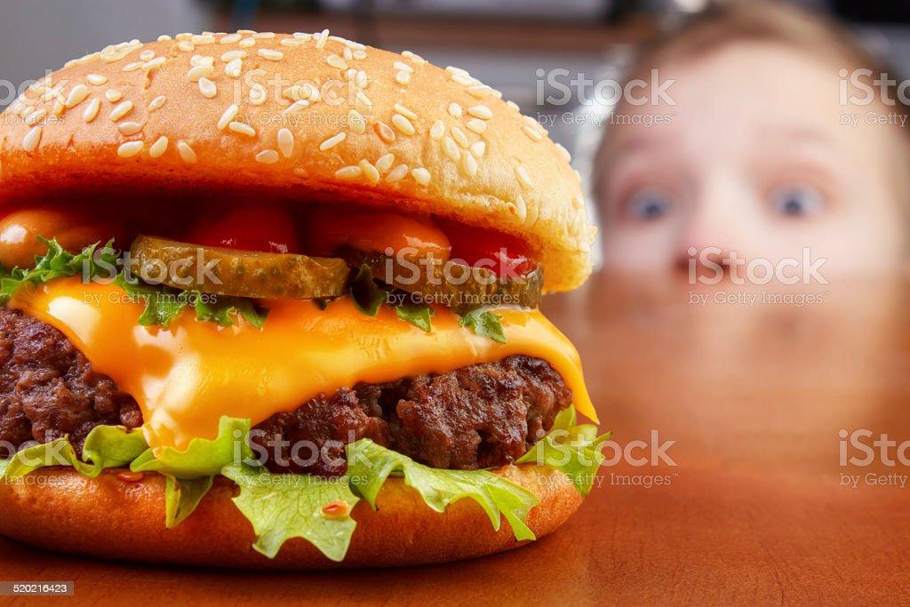 Kid smelling burger royalty-free stock photo