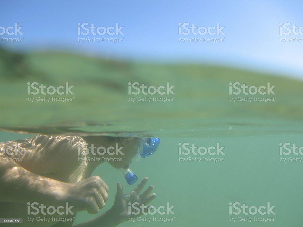 Kid snorkelling underwater royalty-free stock photo