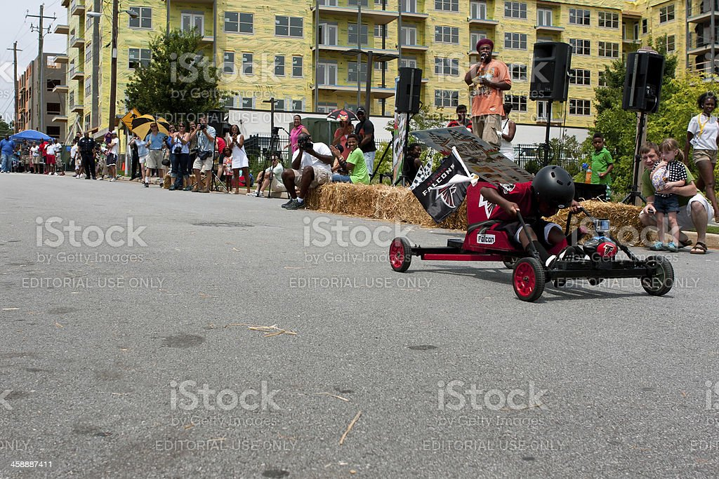 Kid Steers Car Down Hill In Atlanta Soap Box Derby royalty-free stock photo