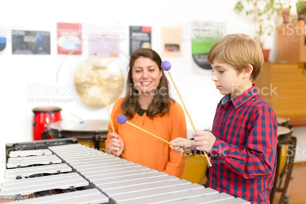 Kid Studying Percussion Instrument stock photo