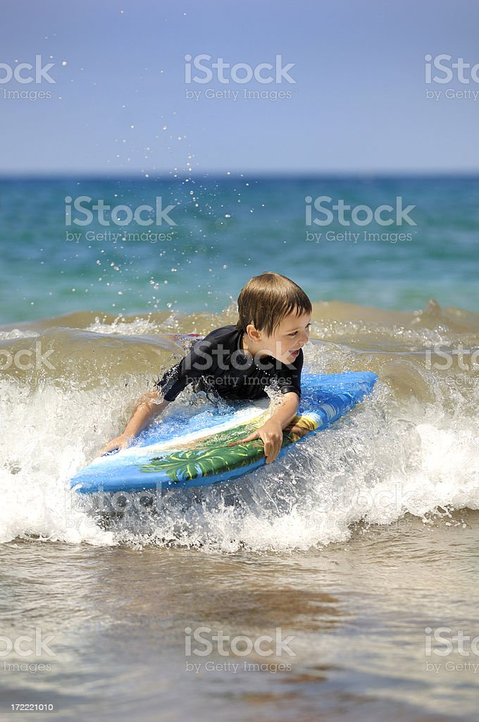 kid surfing royalty-free stock photo