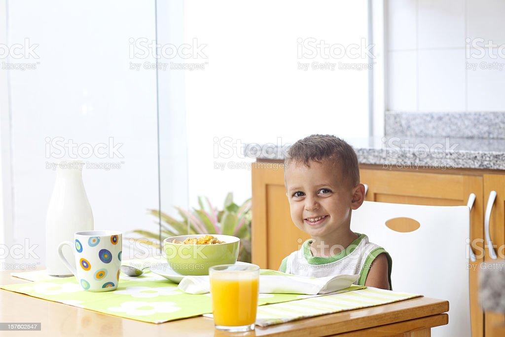 Kid taking breakfast royalty-free stock photo