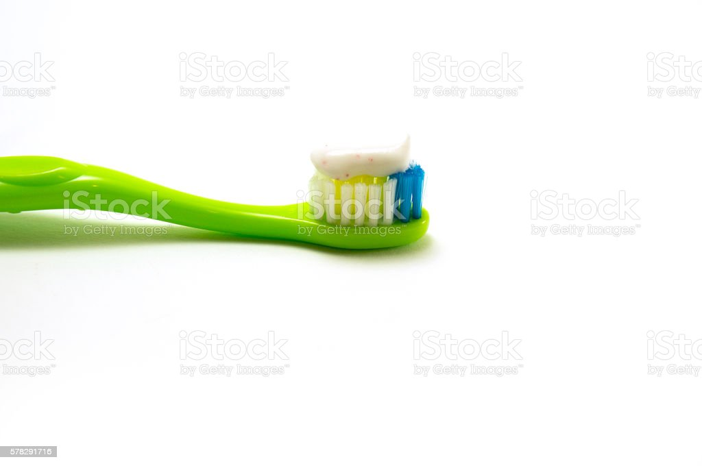 kid toothbrush with toothpaste isolated stock photo