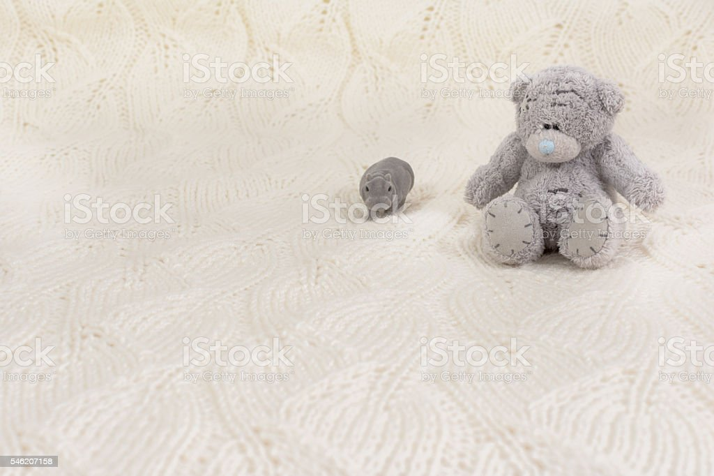 Kid toys on knitted rug stock photo