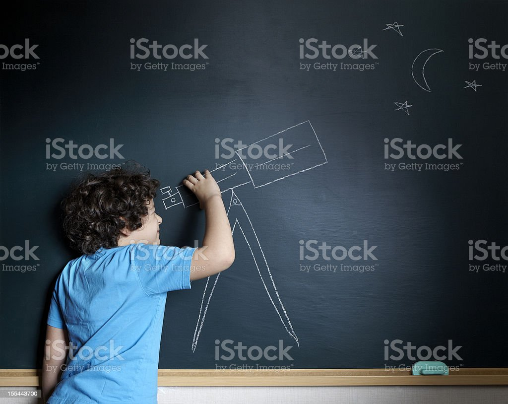 A kid using his imagination to look at stars stock photo