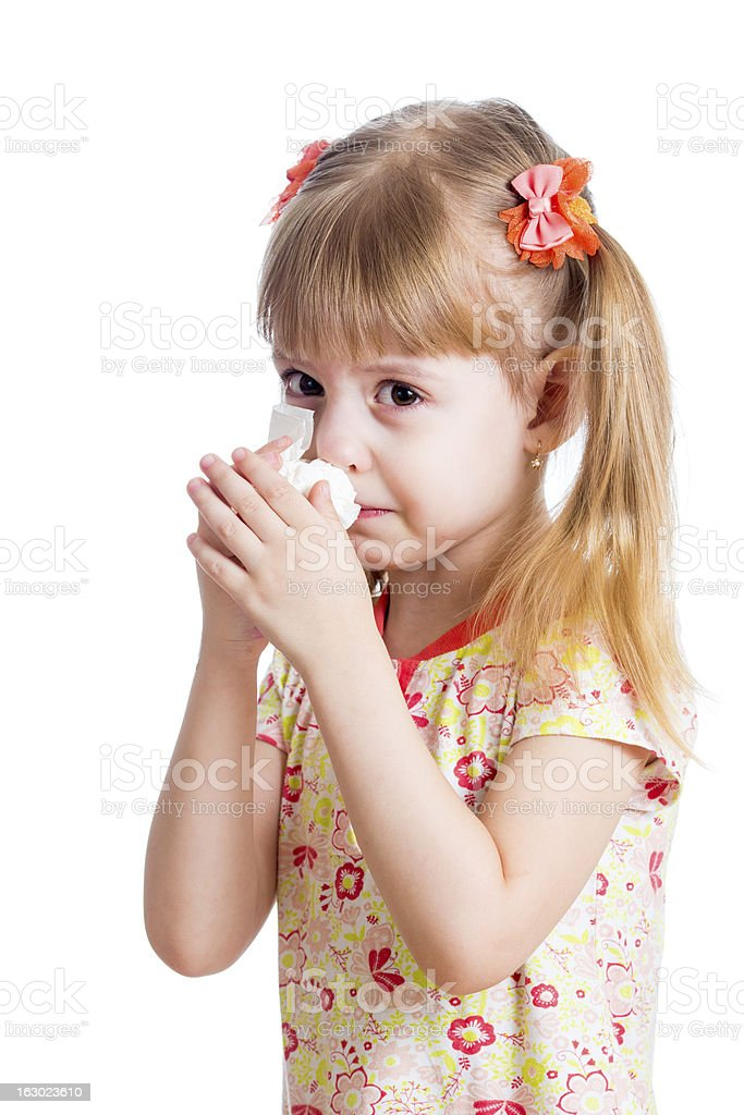 kid wiping or cleaning nose with tissue isolated on white royalty-free stock photo