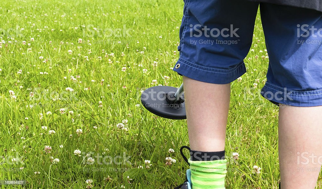 Kid with a metal detector stock photo
