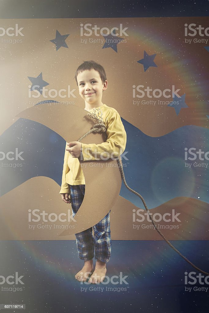 Kid with a paper moon stock photo