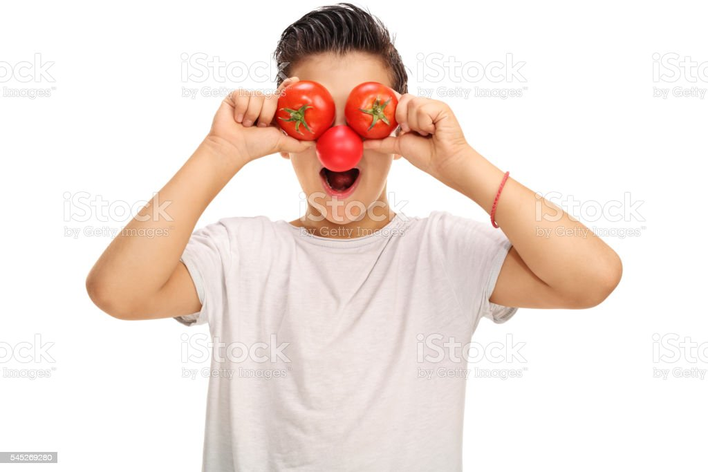 Kid with a red nose and tomato eyes stock photo