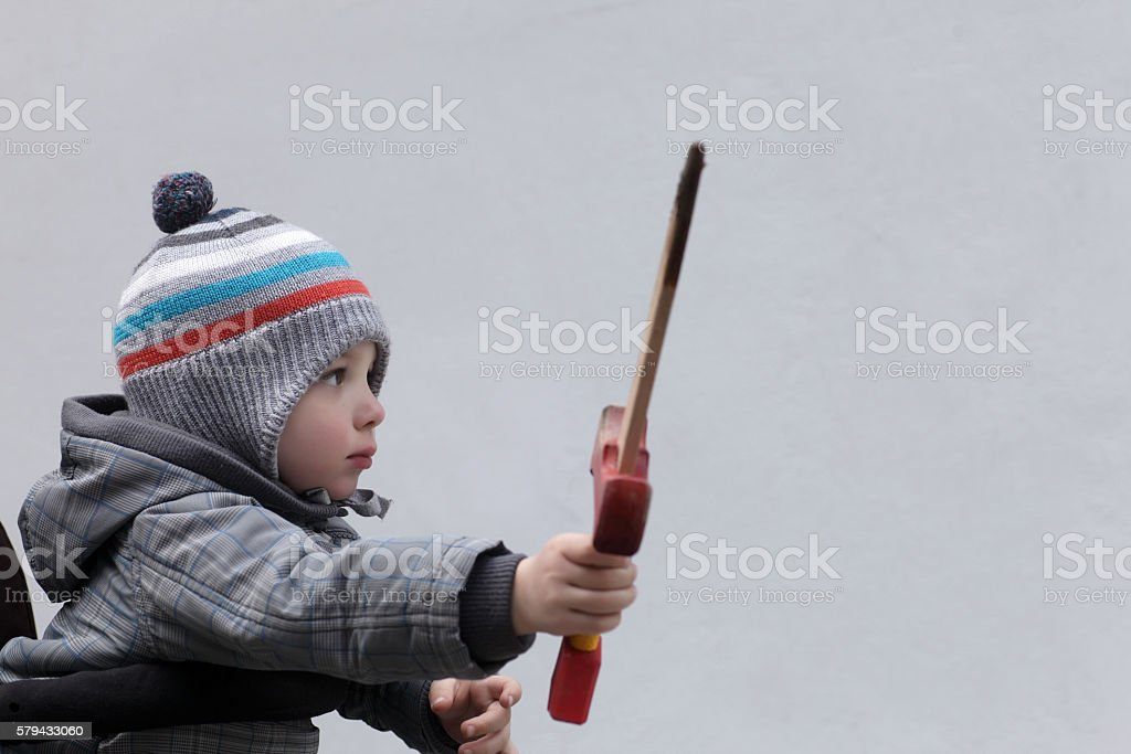 Kid with a wooden dagger stock photo