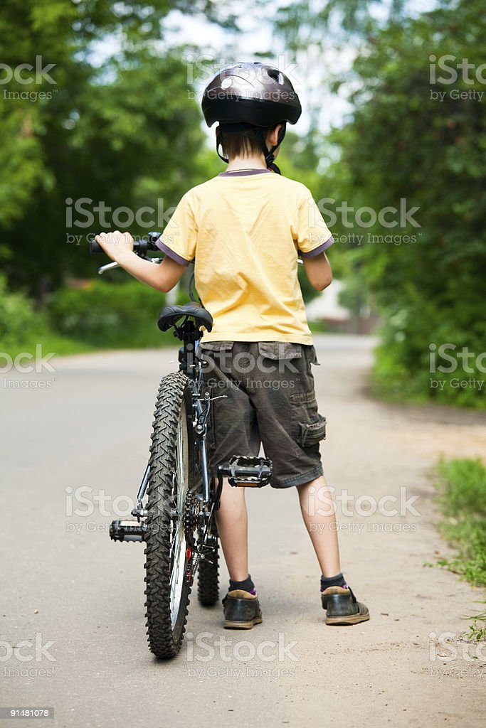 Kid with bicycle royalty-free stock photo