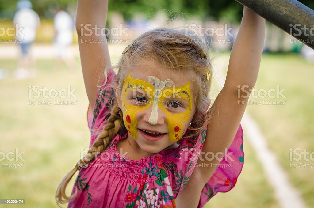 kid with face-painting stock photo