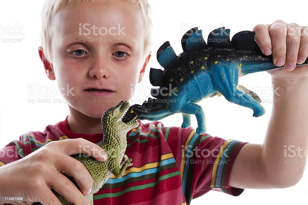 Kid with his dinosaurs royalty-free stock photo