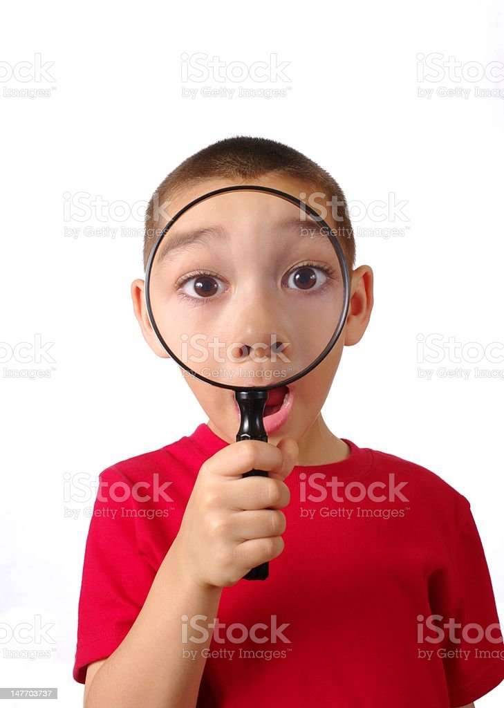 kid with magnifying glass royalty-free stock photo
