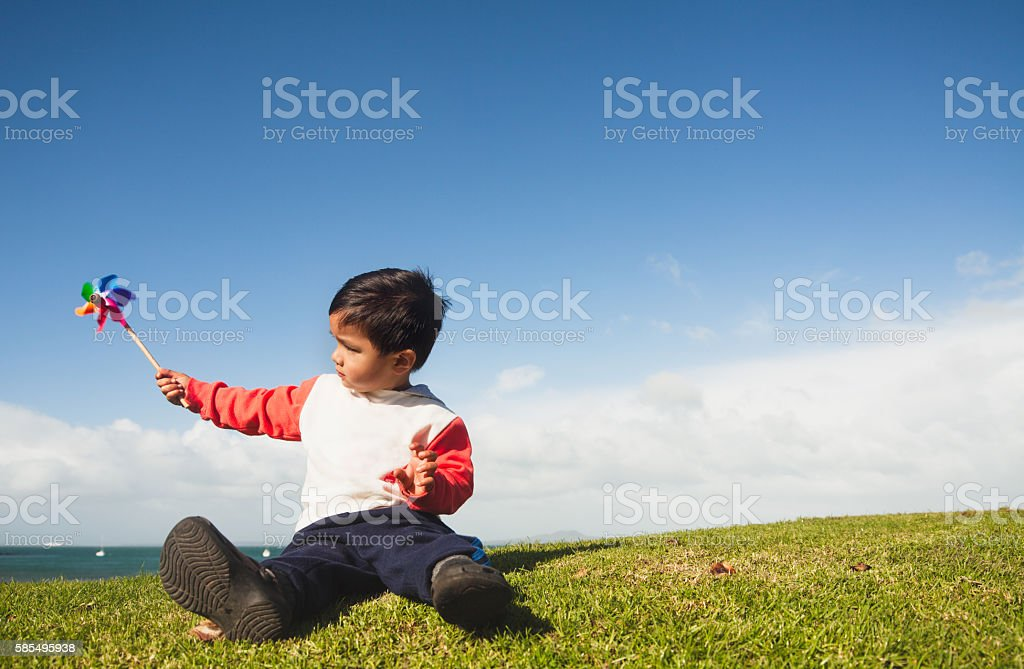 Kid with Pinwheel stock photo
